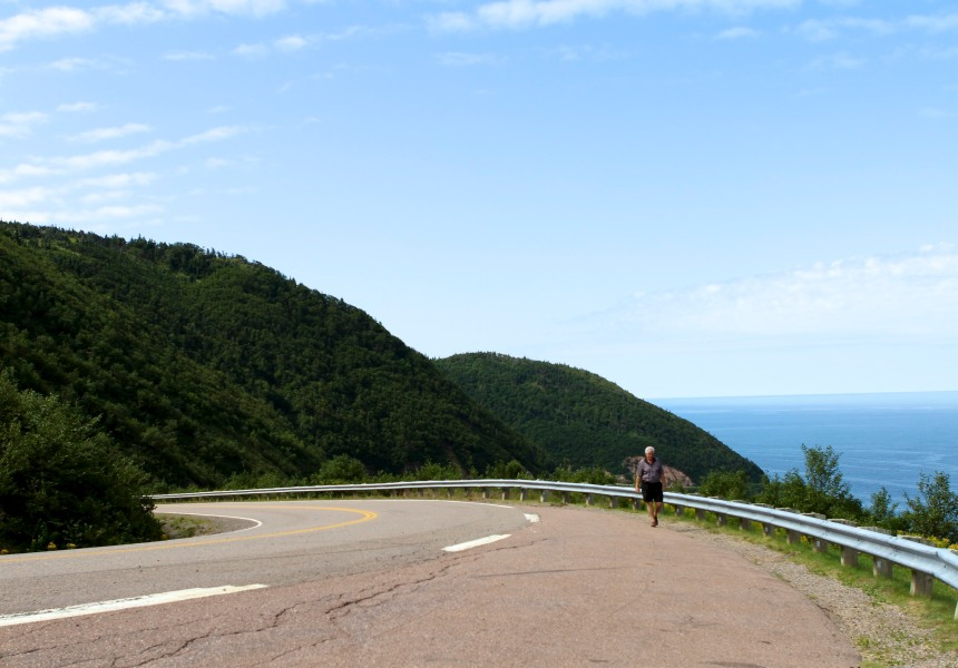 Man walking the Cabot Trail, Nova Scotia by mm