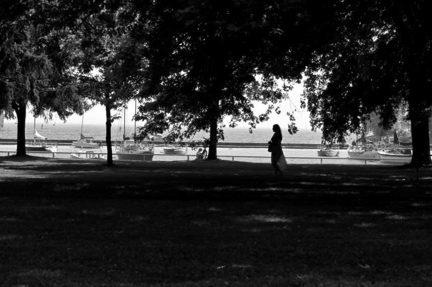 woman walking in the shade of lakeshore