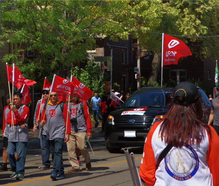 Unifor on the left with flags; Liuna on the right